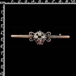 Aguja de pecho 1631, amatista (morado), cobre óxido.