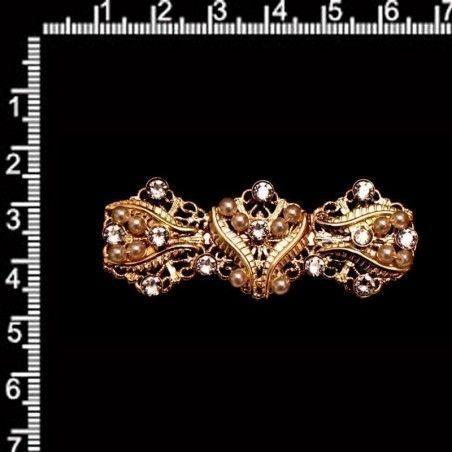 Broche 6001, cristal, oro.
