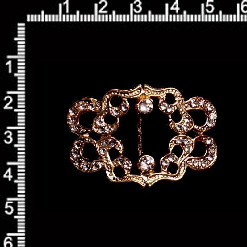 Hebilla 49, cristal, oro.