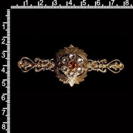 Aguja pecho 610, topacio-cristal, oro.