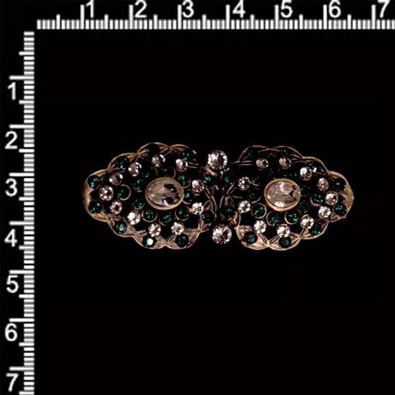 Broche mantilla 240, esmeralda-cristal, latón óxido.