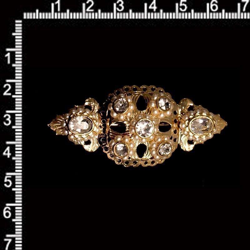 Broche mantilla 931, cristal, oro.