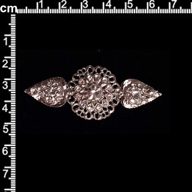 Broche mantilla 2005, cristal, rodio.