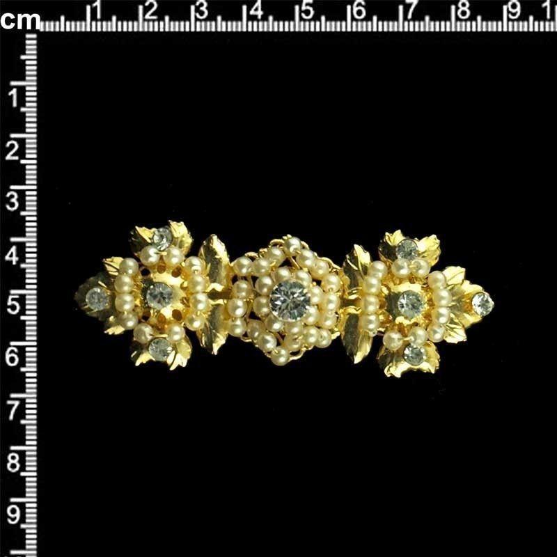 Broche 9202, cristal, oro.