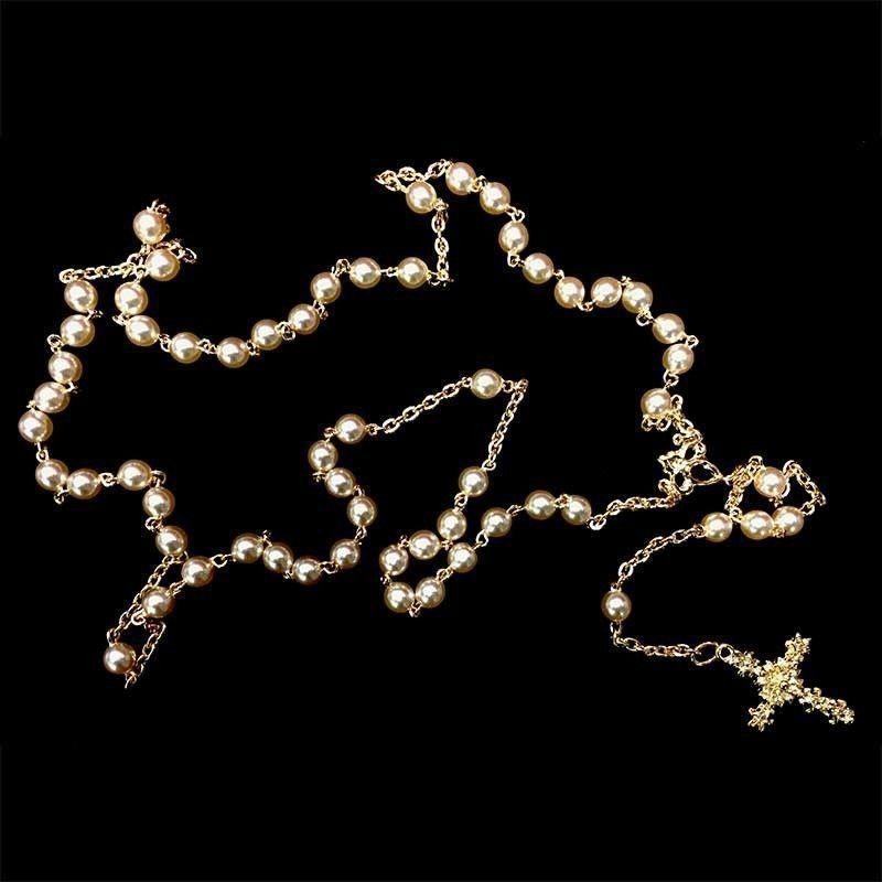 Rosario de perla de 6 mm, oro.