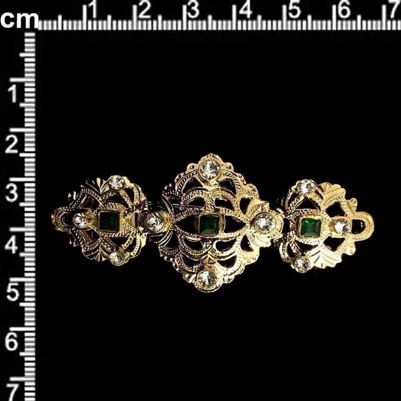 Broche mantilla 801, esmeralda-cristal, oro.