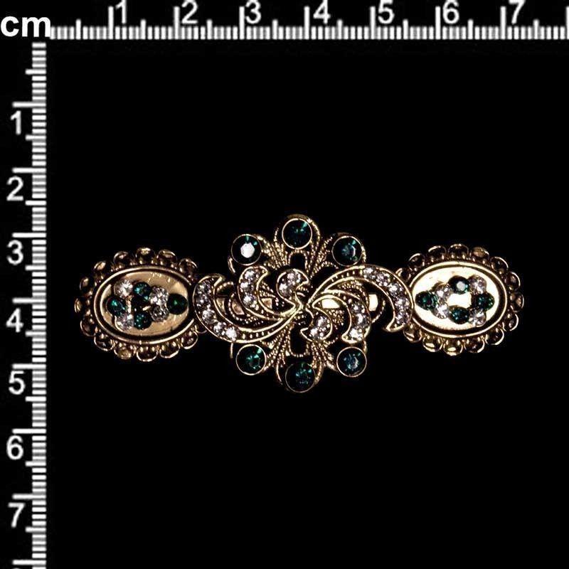 Broche 9806, esmeralda, oro viejo negro.