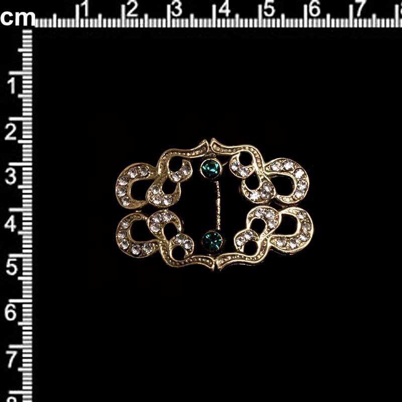 Hebilla 49, esmeralda-cristal, oro viejo negro.