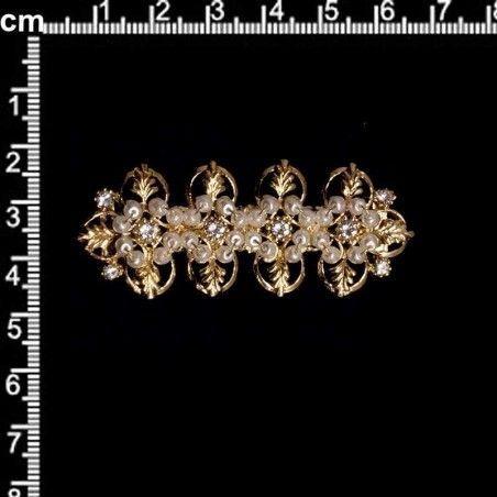 Broche mantilla 104, cristal, oro.