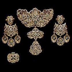Aderezo de valenciana 232, crisolite, oro.
