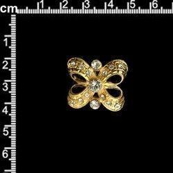 Hebilla 701, cristal, oro.