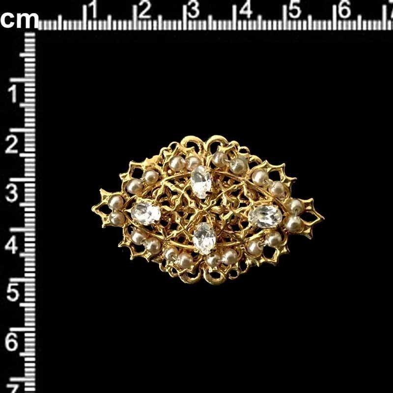 Hebilla 1002, cristal, oro.