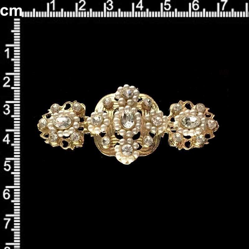 Broche mantilla 2306, cristal, oro.