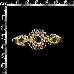 Broche mantilla 2005, esmeralda, oro.