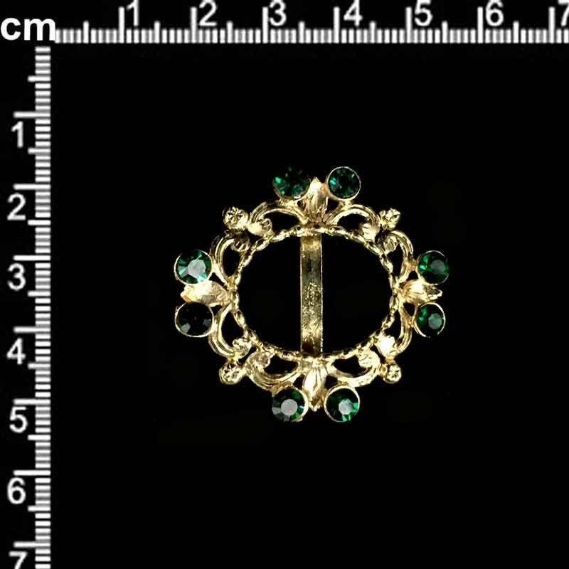 Hebilla 134, esmeralda, oro.