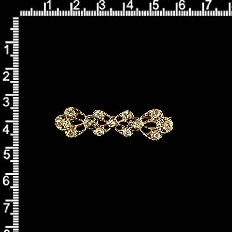 Broche mantilla 2301, cristal, oro.