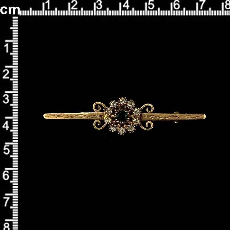 Aguja de pecho 1823, esmeralda, oro viejo marrón.