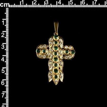Cruz 214, esmeralda, oro.