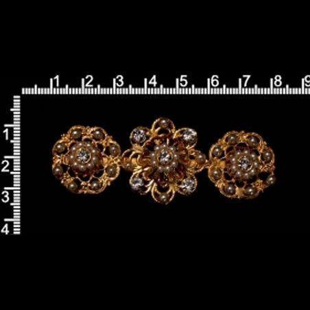 Broche 9802, cristal, oro.
